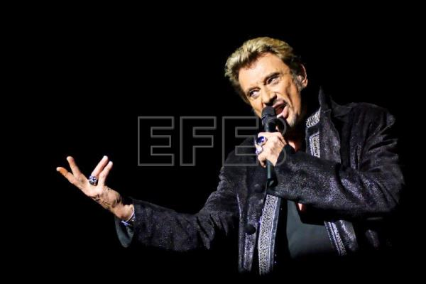 A file picture dated Oct 27, 2006 shows French singer Johnny Hallyday performing on stage during a concert in Brussels, Belgium. EFE-EPA(FILE)/ERIC BOMAL BELGIUM OUT