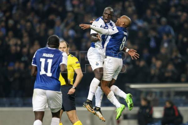 FC Porto's Yacine Brahimi (R) celebrates with Vincent Aboubakar (2R) after scoring a goal against Monaco during their Champions League Group G soccer match held at Dragao stadium, Porto, Portugal, Dec. 6, 2017. EPA-EFE/JOSE COELHO