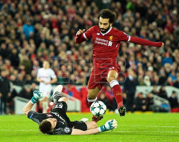 Liverpool's Mohamed Salah (R) in action against Spartak Moscow's goalkeeper Aleksandr Selikhov (L) during the UEFA Champions League group E soccer match between Liverpool FC and Spartak Moscow at Anfield in Liverpool, Britain, Dec. 6, 2017. EPA-EFE/PETER POWELL